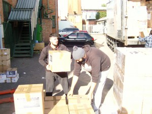 Workers loading boxes in aid of Pakistan Floods